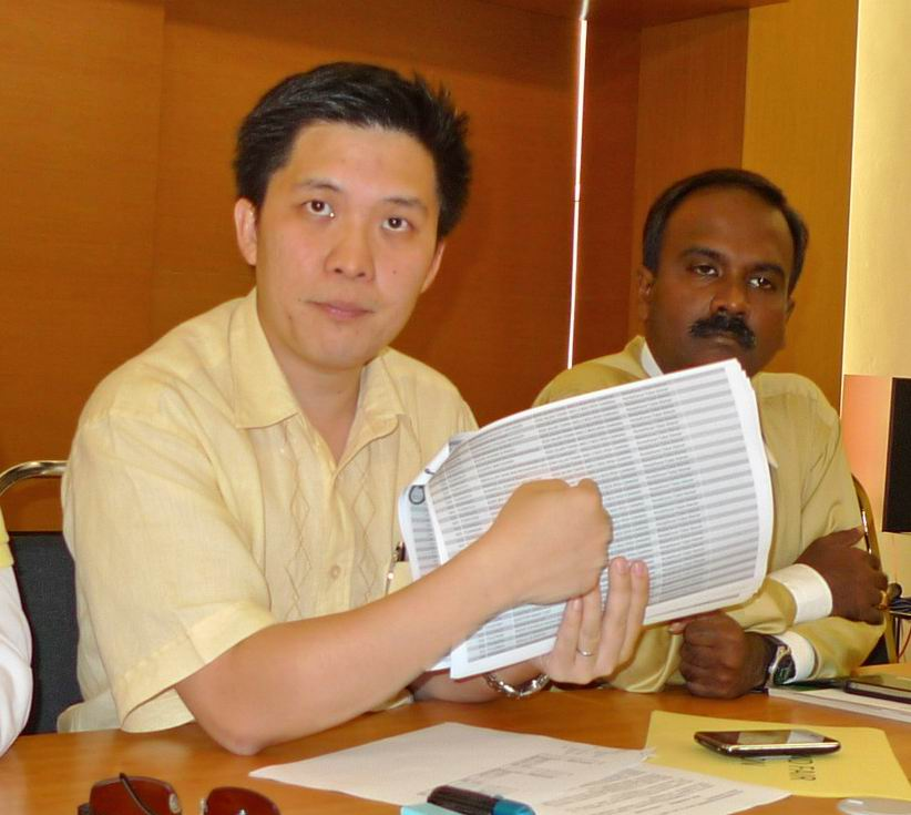 Canning Assemblyman Wong Kah Woh with the list of new postal voters