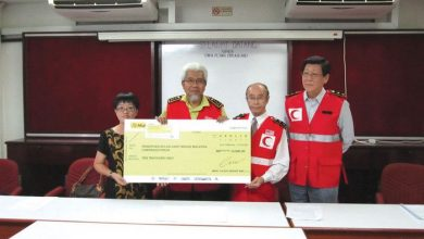 Photo of Donation to Flood Victims