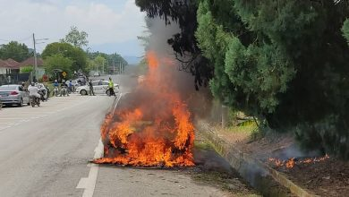 Photo of Car Catches Fire by the Roadside